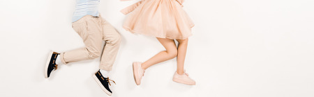 Photo for panoramic shot of kid near friend in pink dress on white - Royalty Free Image
