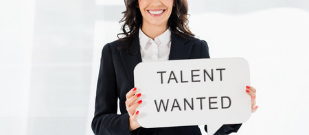 Photo for panoramic shot of cheerful recruiter holding speech bubble with talent wanted lettering - Royalty Free Image