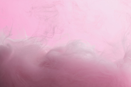 Photo for Close up view of pink paint mixing in water isolated on pink - Royalty Free Image