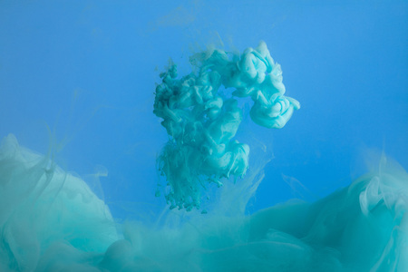 Photo for Close up view of turquoise paint splash isolated on blue - Royalty Free Image