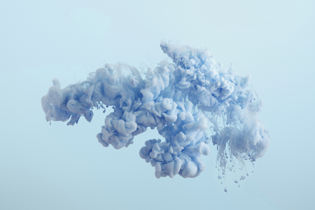 Photo for Close up view of blue paint splash isolated on light blue - Royalty Free Image