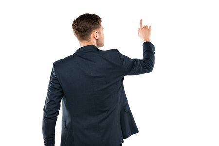 Foto de Back view of businessman in suit pointing with finger while standing isolated on white background - Imagen libre de derechos