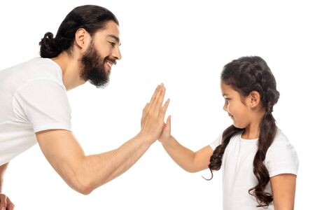 Foto de cheerful latin father giving five to cute daughter isolated on white - Imagen libre de derechos