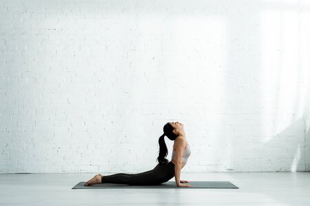 Photo pour Pretty Asian woman doing exercise on yoga mat - image libre de droit