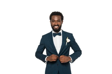 Foto de cheerful bearded african american man touching suit isolated on white - Imagen libre de derechos