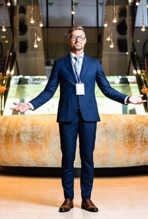 Foto de handsome businessman in suit and glasses with outstretched hands - Imagen libre de derechos