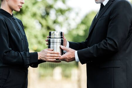Photo for cropped view of senior man and woman holding mortuary urn - Royalty Free Image