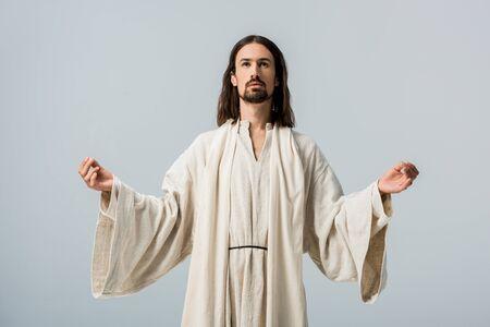Foto de religious man in jesus robe with outstretched hands isolated on grey - Imagen libre de derechos