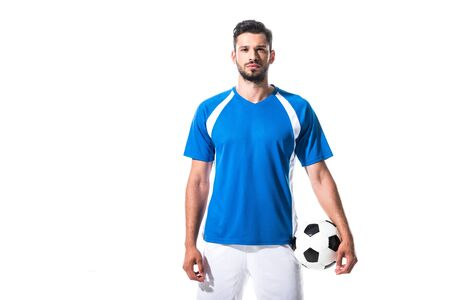 Foto de soccer player holding ball and looking at camera Isolated On White - Imagen libre de derechos