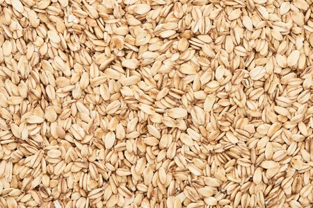 Photo for top view of raw pressed organic oats - Royalty Free Image