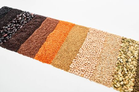 Foto de assorted black beans, rice, quinoa, buckwheat, chickpea, pumpkin seeds and red lentil isolated on white - Imagen libre de derechos