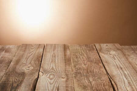 Photo for empty wooden table on brown background with flashlight - Royalty Free Image