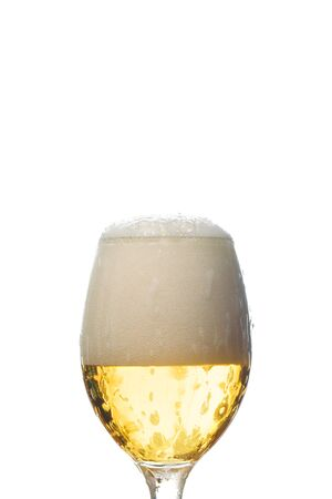 Foto de wet glass of beer with white foam isolated on white - Imagen libre de derechos
