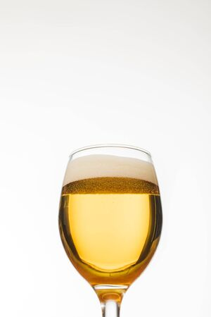 Foto de low angle view of glass of beer with bubbles isolated on white - Imagen libre de derechos