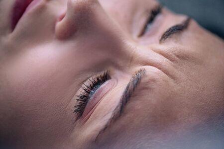 Foto de close up view of beautiful depressed woman at home - Imagen libre de derechos