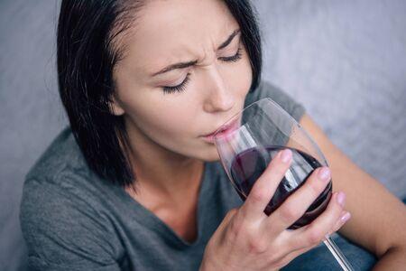 Foto de lonely upset woman drinking wine at home - Imagen libre de derechos