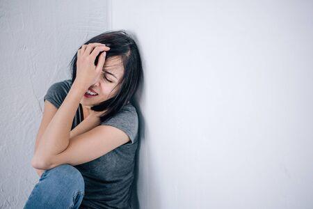 Foto de upset lonely brunette woman crying and covering face at home - Imagen libre de derechos