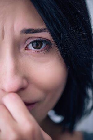 Foto de beautiful depressed woman looking at camera at home - Imagen libre de derechos