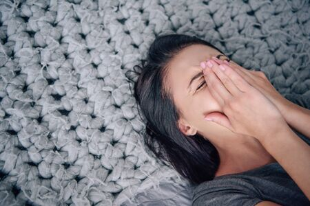 Foto de beautiful depressed woman lying on bed and crying at home - Imagen libre de derechos