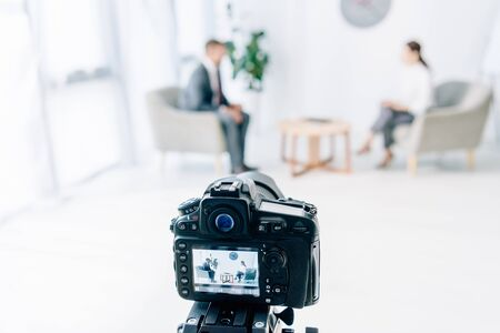 Photo for selective focus of digital camera shooting businessman and journalist - Royalty Free Image