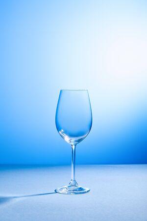Foto de empty, clean and fragile glass on blue background with copy space - Imagen libre de derechos