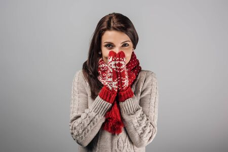 Photo pour woman in red gloves and scarf covering face isolated on grey - image libre de droit