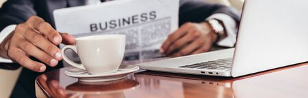 Photo for panoramic shot of businessman taking cup in private plane - Royalty Free Image