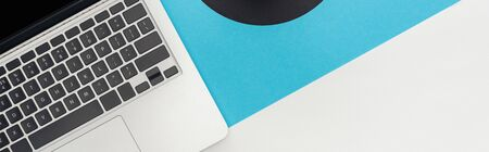 Foto de top view of laptop on abstract geometric background, panoramic shot - Imagen libre de derechos