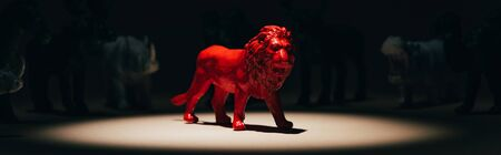 Photo for Panoramic shot of red toy lion under spotlight with animals at background, voting concept - Royalty Free Image