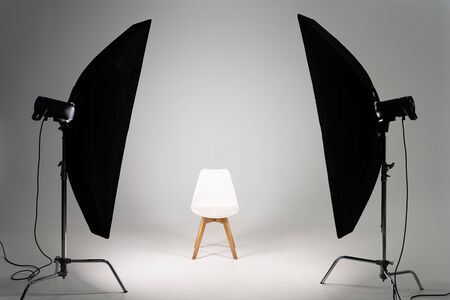 Photo for White modern chair with studio light on grey background - Royalty Free Image