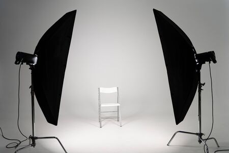 Photo for White chair with studio light on grey background - Royalty Free Image