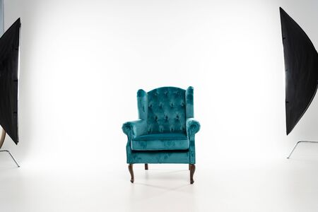 Photo for Turquoise armchair with studio light on white background - Royalty Free Image