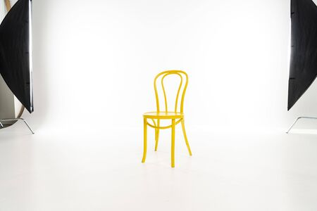 Photo for Yellow chair with studio light on white background - Royalty Free Image