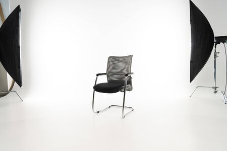 Photo for Black modern chair with studio light on white background - Royalty Free Image
