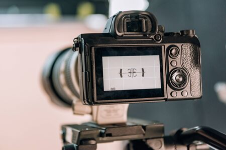 Photo for Selective focus of electronic level on camera display in photo studio - Royalty Free Image