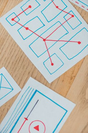 Foto de Top view of ux application layouts on wooden table - Imagen libre de derechos