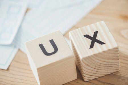 Foto de Selective focus of cubes with ux letters and layouts on table - Imagen libre de derechos