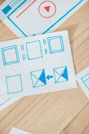 Foto de Top view of user experience design sketches on wooden table - Imagen libre de derechos