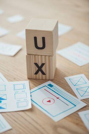 Foto de Selective focus of website template layouts and cubes with ux letters on table - Imagen libre de derechos