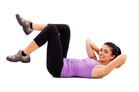 Photo for Pretty female fitness trainer doing warming up exercises. - Royalty Free Image