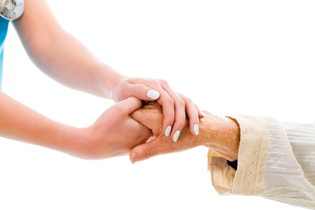 Foto de Supporting hands for senior woman - doctor and elderly patient. - Imagen libre de derechos