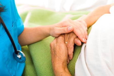 Foto de Care help love and trust to elderly people - holding hands. - Imagen libre de derechos