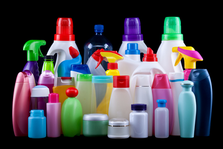 Photo pour Usual plastic bottles from a household isolated on black - pollution and environment concept - image libre de droit