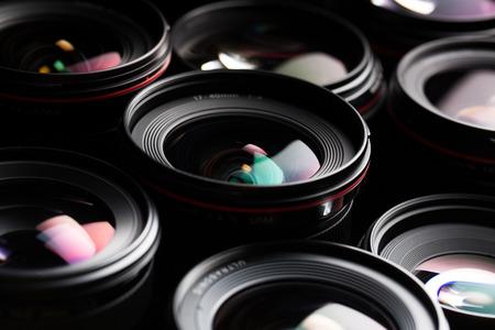 Foto de Modern camera lenses with reflections, low key image - Imagen libre de derechos