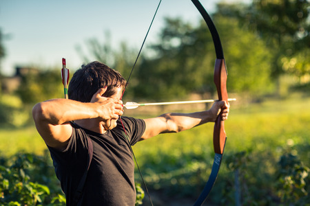 Photo for Young archer training with the  bow - Royalty Free Image
