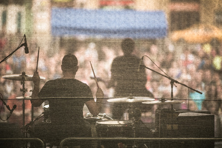 Photo for Band performing live on a stage, in front of huge crowd - Royalty Free Image