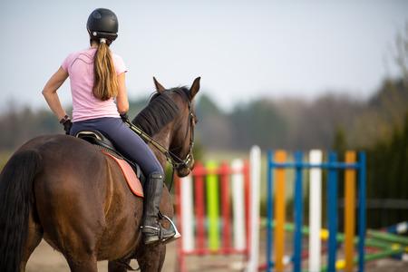 Photo pour Young woman show jumping with horse - image libre de droit