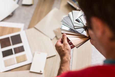 Photo pour Man chosing the right flooring for his house/appartement - image libre de droit