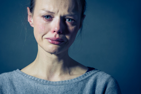 Foto de Young woman suffering from severe depression/anxiety/sadness, crying, tears coming from her eyes - Imagen libre de derechos
