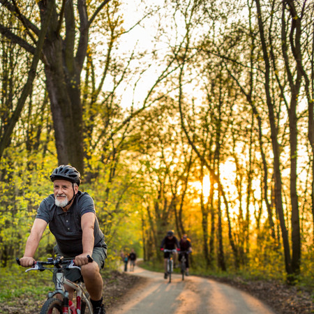Photo pour Senior man on his mountain bike outdoors (shallow DOF; color toned image) - image libre de droit
